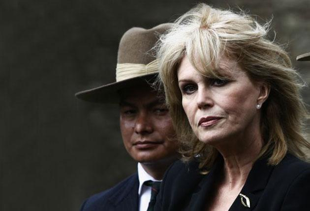 British actress Joanna Lumley stands with former Gurkha soldiers as she speaks to media in front of the Houses of Parliament after appearing at a select committee session, in May 2009