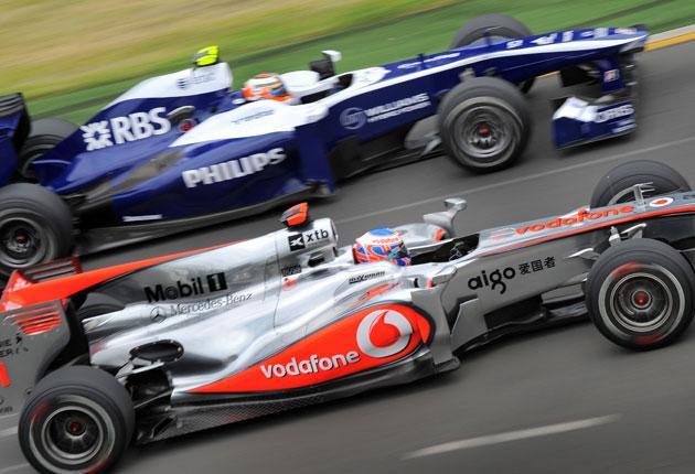 Button speeds through a corner with Williams driver Nico Hülkenberg