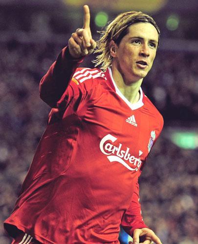 The Spanish striker Fernando Torres 'can improve' according to his Liverpool manager Rafa Benitez