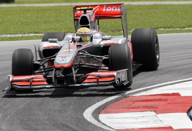 Lewis Hamilton practises in his McLaren for tomorrow's Malaysian Grand Prix