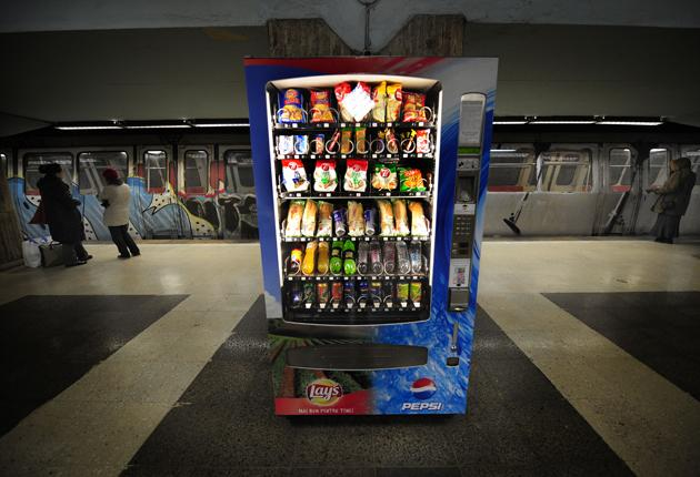 A vending machine in a station in Bucharest. Romania is to introduce a levy on foods that are high in fat, sugar and salt in a bid to improve the health of the nation