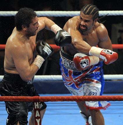 David Haye (right) lands one of his many heavy blows on John Ruiz during Saturday night's WBA heavyweight title fight in Manchester