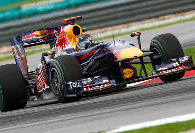 Red Bull's Sebastian Vettel on his way to victory in yesterday's Malaysian Grand Prix at the Sepang circuit