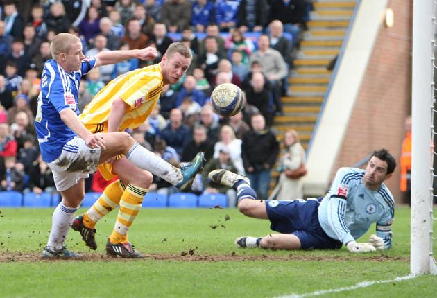 Kevin Nolan beats the Peterborough defence to score Newcastle's first goal