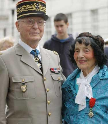 Peel with her brother, General Virot, after he had presented her with her award as Chevalier of the Légion d'Honneur in 2004