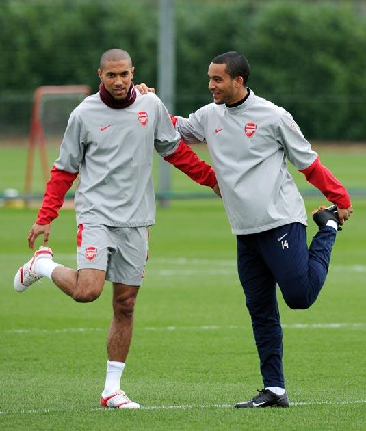 ap  Theo Walcott (right) appears in relaxed mood as he trains with Gaël Clichy yesterday