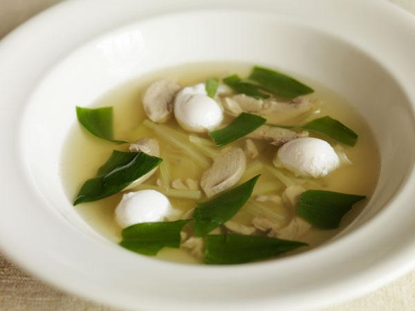 Quail and celery broth with poached eggs and wild garlic