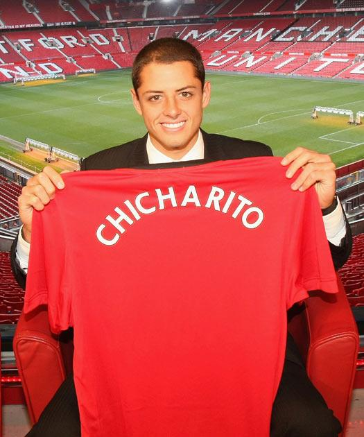Javier Hernandez poses with a Manchester United shirt with his nickname Chicharito on the back