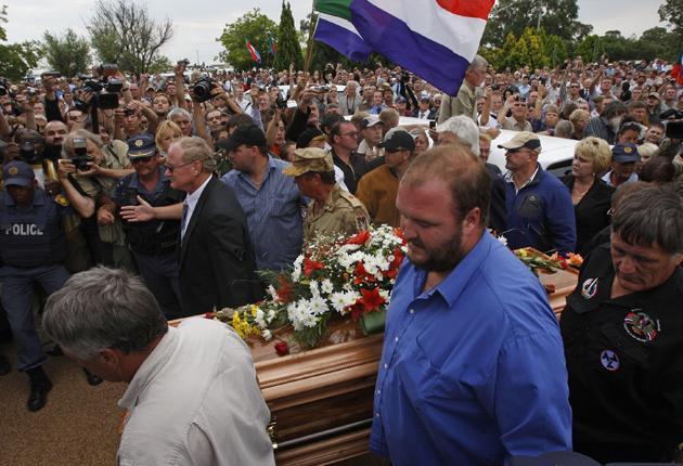 Far-right South Africans gather to mourn slain leader Eugene Terreblanche yesterday in Ventersdorp