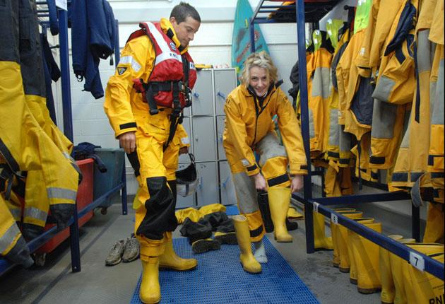 Bear Grylls and reporter Rachel Shields take part in a training day to learn how to capsize safely at the Royal National Lifeboat Institution's sea survival centre in Poole, Dorset