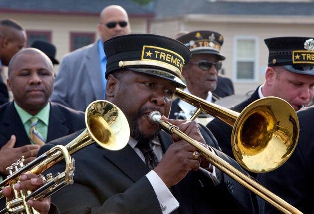 And the band played on: Wendell Pierce, as the trombonist Antoine Batiste, leads a funeral march to the cemetery in the first episode of 'Treme'