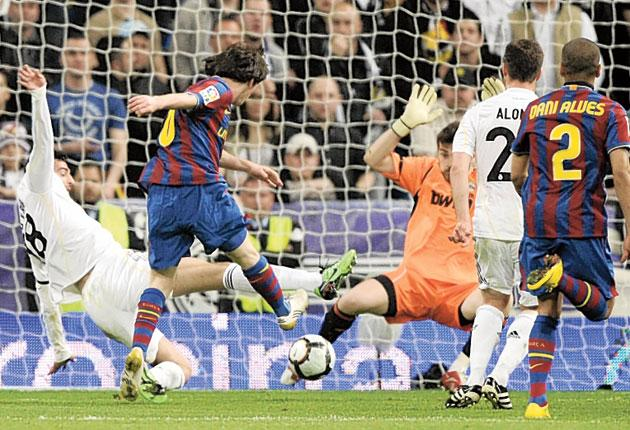 Lionel Messi scores Barca's first goal against Real Madrid on Saturday