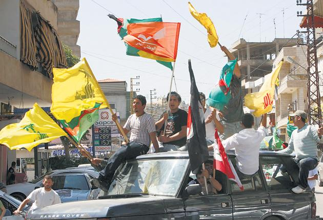 Supporters of Hizbollah, which is represented in the Lebanese parliament, in the southern city of Nabatieh, Lebanon