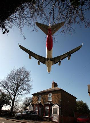 A passenger jet comes in to land at Heathrow. Labour is the only party that would allow the building of a third runway at the airport