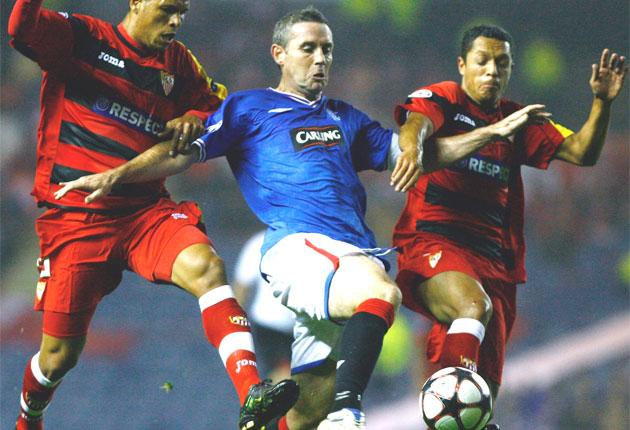 David Weir, the Rangers captain (centre), was named as the Scottish Premier League's player of the year on Monday night after the 39-year-old enjoyed another solid season in the centre of their defence