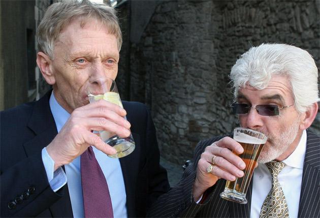 John Doyle (left) and Robert Graham celebrating their release yesterday