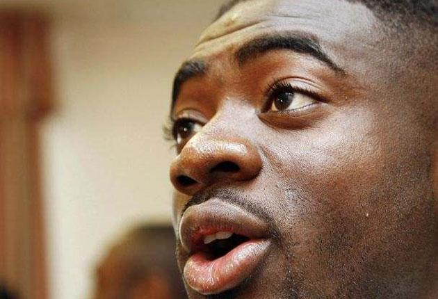 Ivorian defender Abib Kolo Toure answers reporters' questions