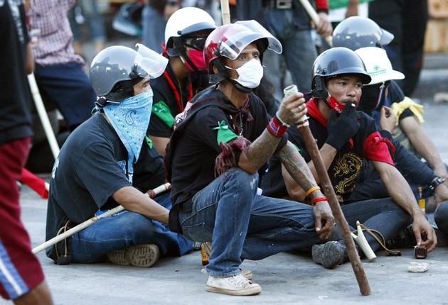 Opposition protesters with home-made weapons in Bangkok yesterday
