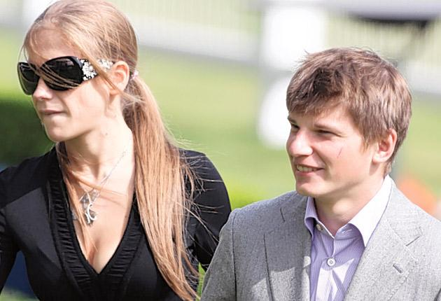 Arsenal's Andrei Arshavin, seen with his wife Yulia, was one of 19,000 punters enjoying a free day at Ascot as part of the Racing for Change initiative