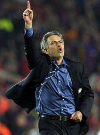Jose Mourinho celebrates after Internazionale's triumph