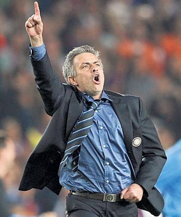 Jose Mourinho celebrates after Internazionale's triumph last night