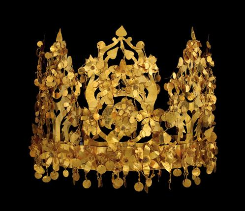 A solid gold crown from one of the six graves of Bactrian nomads discovered at Tillya Tepe in northern Afghanistan in 1978. The crown, from the first century AD, was collapsible for easy transport