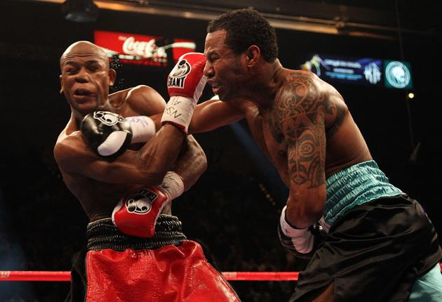 Floyd Mayweather (left) resisted an early onslaught by his fellow American Shane Mosley