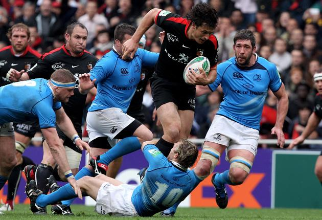 Yannick Jauzion, of Toulouse, is tackled by Shaun Berne during the Heineken Cup tie with Leinster at Stade Municipal on Saturday