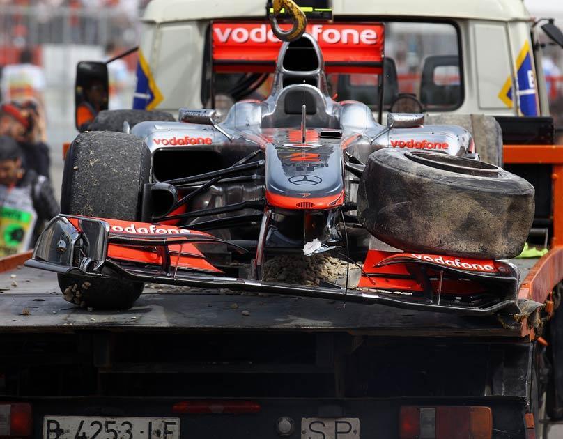 Hamilton's McLaren is taken away