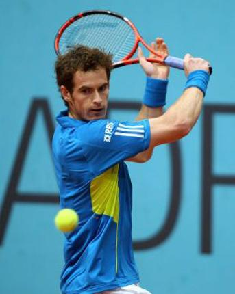 Andy Murray plays a backhand during his impressive 6-3, 6-3 victory over Argentina's Juan Ignacio Chela at the Madrid Masters