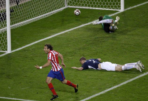 Atletico's Diego Forlan celebrates scoring the winning goal in the Europa League final between Atletico Madrid and Fulham