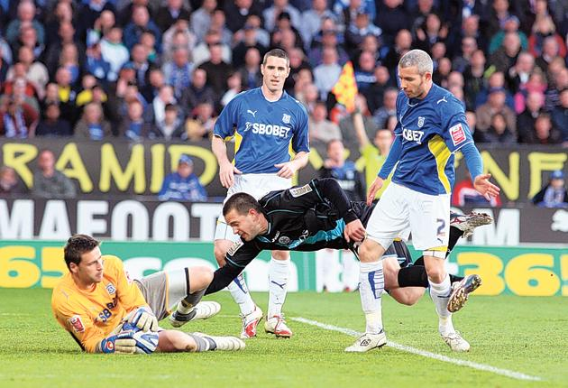 Matt Fryatt of Leicester tumbles over Cardiff's Kevin McNaughton in the Championship play-off second leg