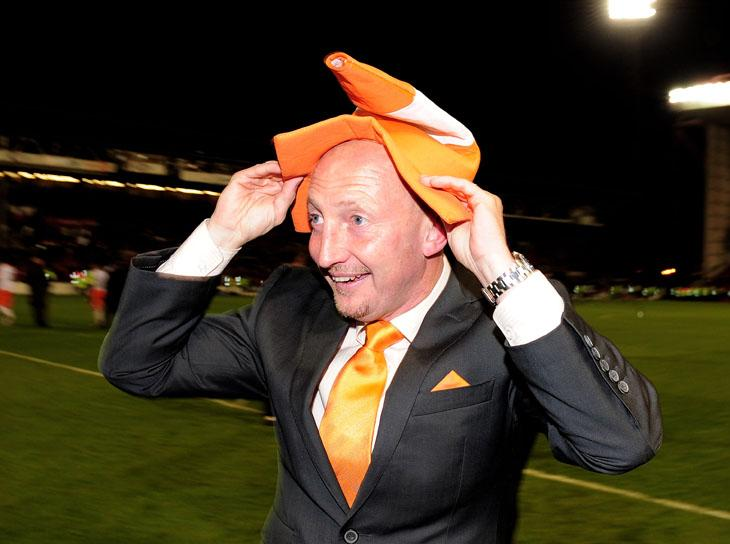 Manager Ian Holloway celebrates Blackpool's towering achievement of reaching the Championship play-off final