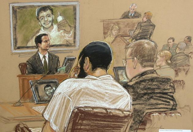 Canadian defendant Omar Khadr, left, with his defence team in Guantanamo's court