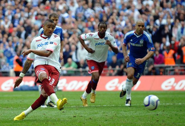 Kevin-Prince Boateng hits his penalty, only to find Petr Cech had read his style