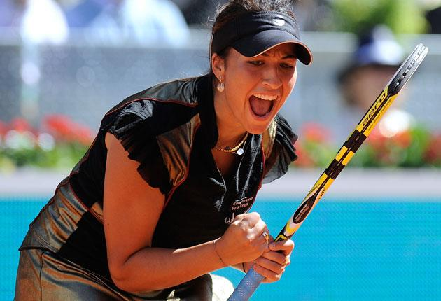 Aravane Rezai takes in the moment of surprise victory over Venus Williams in Madrid