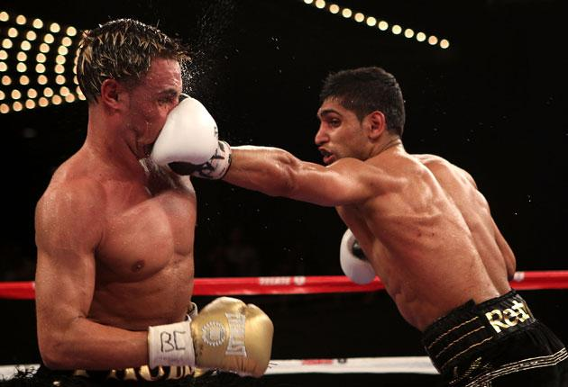 Ami Khan connects yet again with Paulie Malignaggi to launch his Stateside career with an impressive 11th-round stoppage of the New Yorker at Madison Square Garden on Saturday night