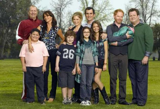We all stand together: the cast of 'Modern Family' includes Jesse Tyler Ferguson and Eric Stonestreet as a gay couple with an adopted Vietnamese baby