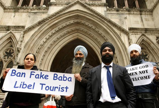 Freelance journalist Hardeep Singh (second right) with supporters outside the Royal Courts of Justice