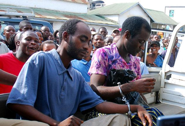 Steven Monjeza and Tiwonge Chimbalanga sit in a pick-up truck before appearing at a magistrate court in Blantyre