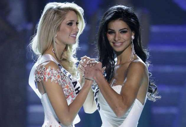 Rima Fakih, the new Miss America, right, with Miss Oklahoma, is the first Arab-American to claim the crown. Condemnation in Islamic circles has been notable for its absence
