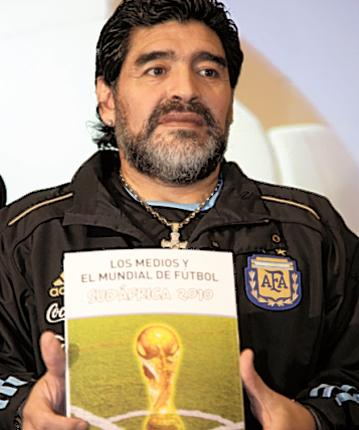 Argentina manager Diego Maradona knocked over a cameraman on the way to announce his 23-man finals squad in Buenos Aires