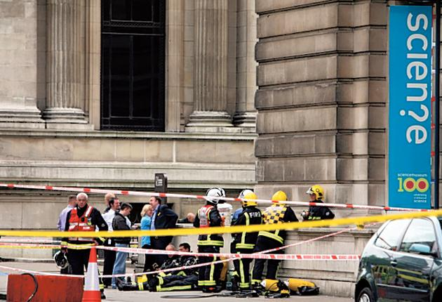 Firemen outside the Science Museum in South Kensington, which was closed after a 'chemical incident' which injured three members of staff