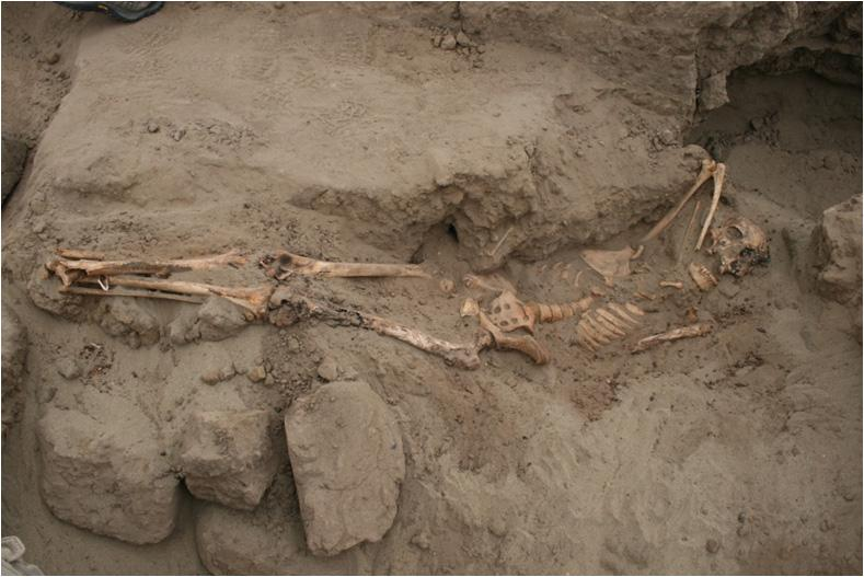 This adolescent woman was buried inside the pyramid. Her feet are close together indicating that they were bound. Her knees also show evidence of ritual burning. It's possible that she was sacrificed however the skeletal analysis found no evidence of trau