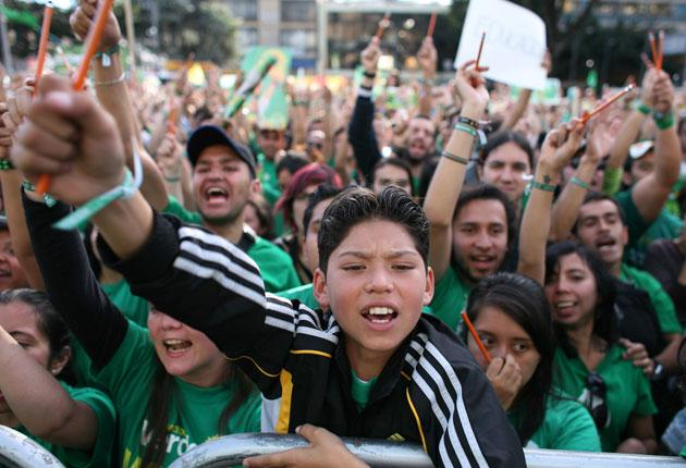 Green Party supporters show their backing for Mockus at a campaign rally in Bogota last Sunday