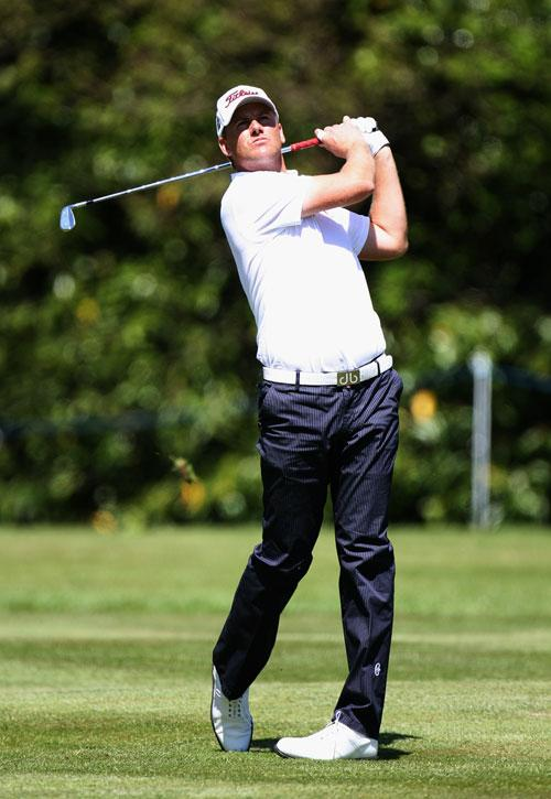 Robert Karlsson plays his third shot to the much-criticised 18th green at the PGA yesterday. He lies two adrift of the leader, England's Chris Wood