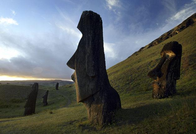 One of Easter Island's 800-year-old statues gazes out from its hillside vantage point.