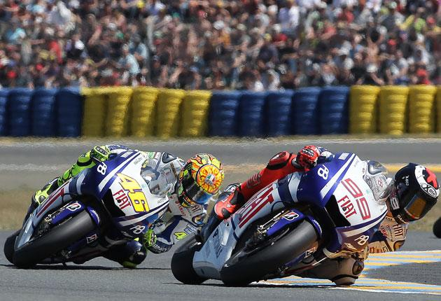 Jorge Lorenzo (right) rides his Yamaha to victory at Le Mans yesterday
