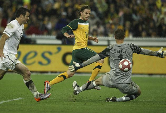 Brett Holman scores Australia's winner in the dying seconds of their friendly against New Zealand