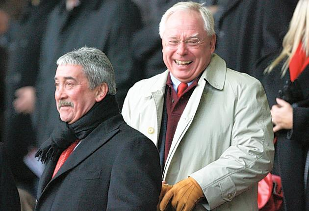 David Moores (left) and George Gillett share a joke during happier times for Liverpool in 2007, before the cracks in Gillett and Tom Hicks' ownership began to show